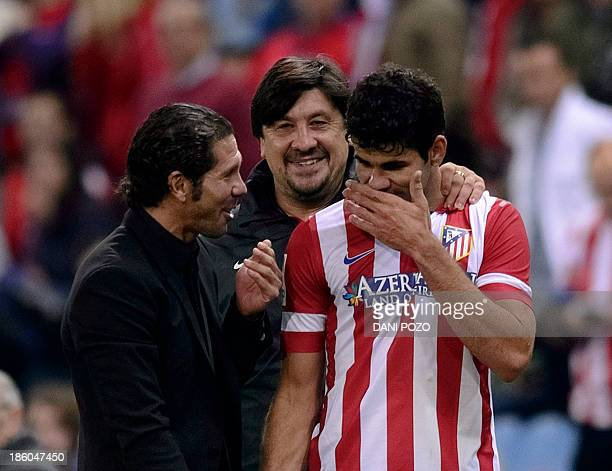 Atletico Madrid's coach Diego Simeone greets Atletico Madrid's Brazilian forward Diego da Silva Costa during the Spanish league football match Club...