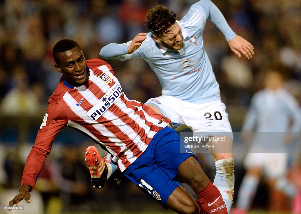 Atletico Madrid's Colombian forward Jackson Martínez vies with Celta Vigo's defender Sergi Gomez during the Spanish Copa del Rey football match Celta...