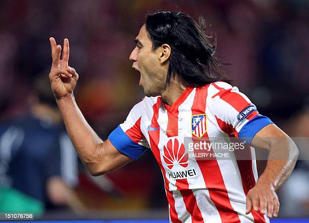 Atletico Madrid's Colombian forward Radamel Falcao celebrates after scoring a third goal during the UEFA Super Cup football match Chelsea FC versus...