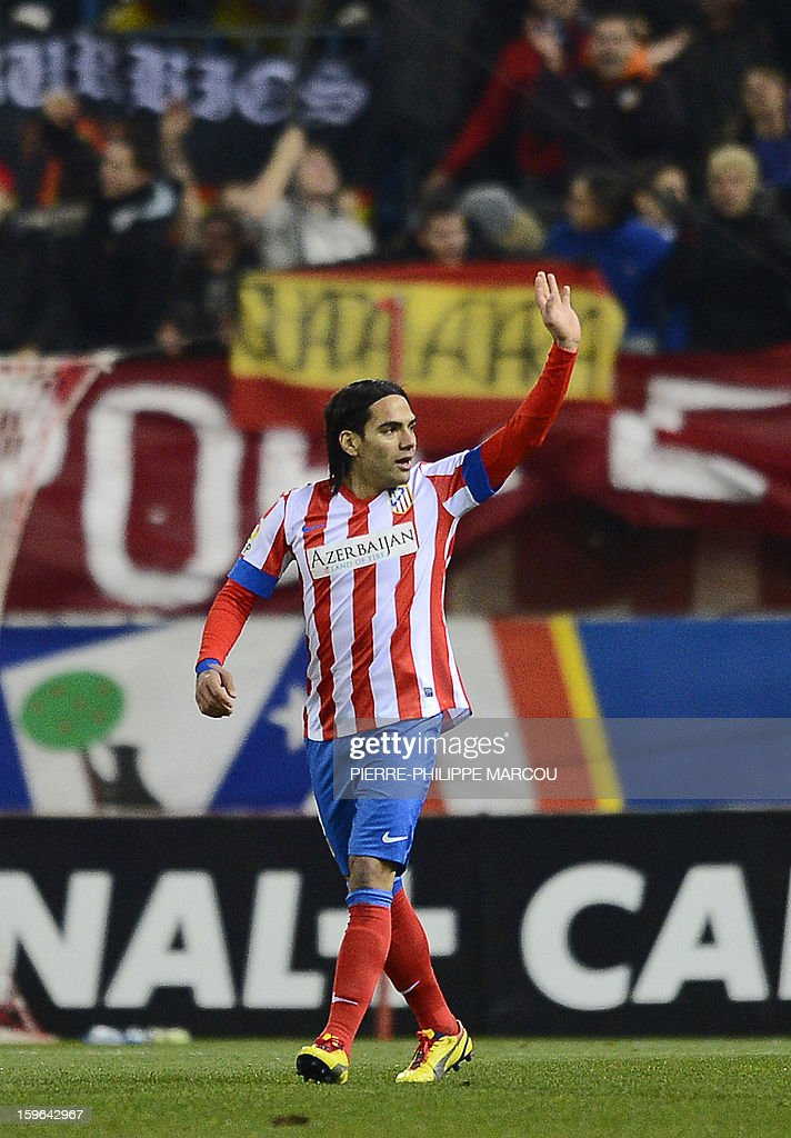 Atletico Madrid's Colombian forward Radamel Falcao celebrates after scoring during the Spanish Copa del Rey (King's Cup) quarter-final first leg football match Club Atletico de Madrid vs Real Betis at the Vicente Calderon stadium in Madrid on January 17, 2013.