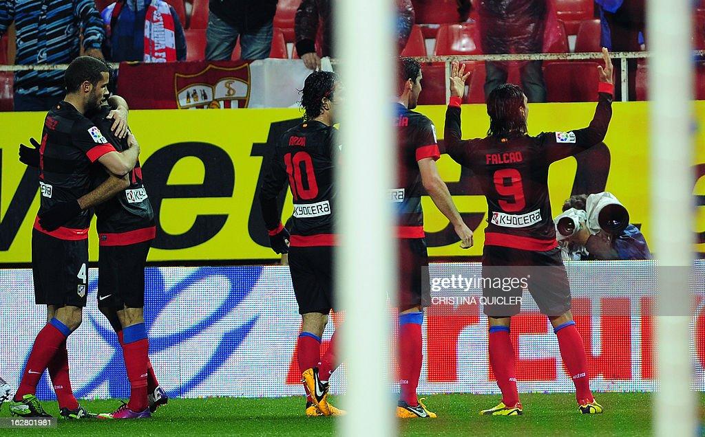 Atletico Madrid's Colombian forward Radamel Falcao (R) celebrates after scoring during the Copa del Rey (King's Cup) semi-final second leg football match Sevilla FC vs Atletico de Madrid at the Ramon Sanchez Pizjuan staduim in Sevilla on February 27, 2013.