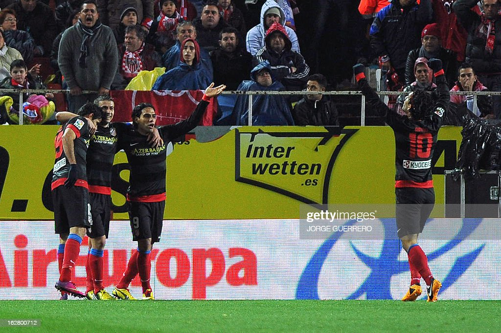 Atletico Madrid's Colombian forward Radamel Falcao (2nd R) celebrates with his teammates after scoring during the Copa del Rey (King's Cup) semi-final second leg football match Sevilla FC vs Atletico de Madrid at the Ramon Sanchez Pizjuan staduim in Sevilla on February 27, 2013.