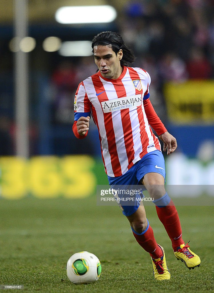 Atletico Madrid's Colombian forward Radamel Falcao drives the ball during the Spanish Copa del Rey (King's Cup) quarter-final first leg football match Club Atletico de Madrid vs Real Betis at the Vicente Calderon stadium in Madrid on January 17, 2013.
