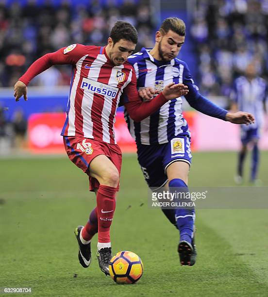 Atletico Madrid's Croatian defender Sime Vrsaljiko vies with Deportivo Alaves' French defender Theo Hernandez during the Spanish league football...