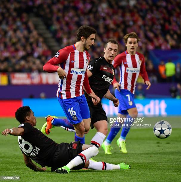 Atletico Madrid's Croatian defender Sime Vrsaljko vies with Leverkusen's Brazilian defender Wendell during the UEFA Champions League round of 16...