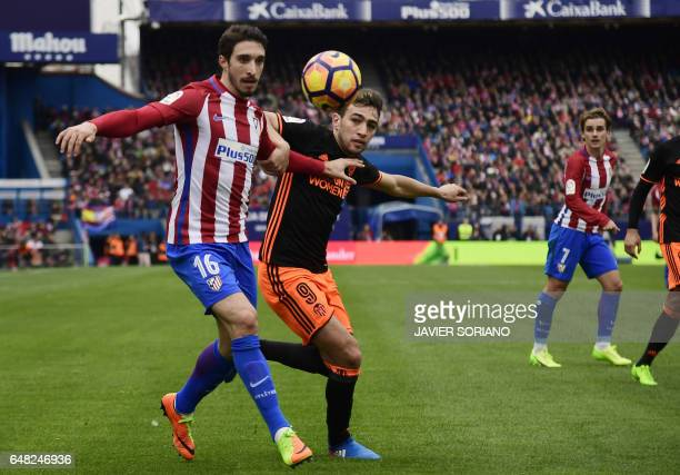 Atletico Madrid's Croatian defender Sime Vrsaljko vies with Valencia's forward Munir El Haddadi during the Spanish league football match Club...
