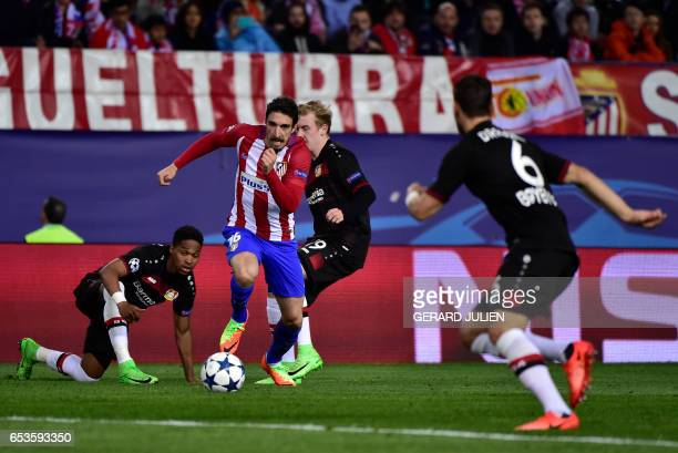 Atletico Madrid's Croatian midfielder Sime Vrsaljko controls a ball next to Leverkusen's Brazilian defender Wendell during the UEFA Champions League...