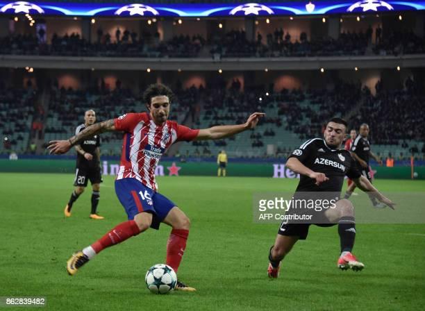 Atletico Madrid's defender from Croatia Sime Vrsaljko and Qarabag's defender from Azerbaijan Gara Garayev vie for the ball during the UEFA Champions...