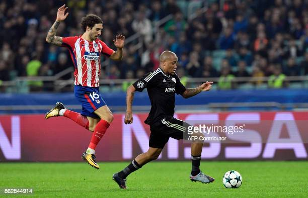 Atletico Madrid's defender from Croatia Sime Vrsaljko and Qarabag's forward from South Africa Dino Ndlovu vie for the ball during the UEFA Champions...