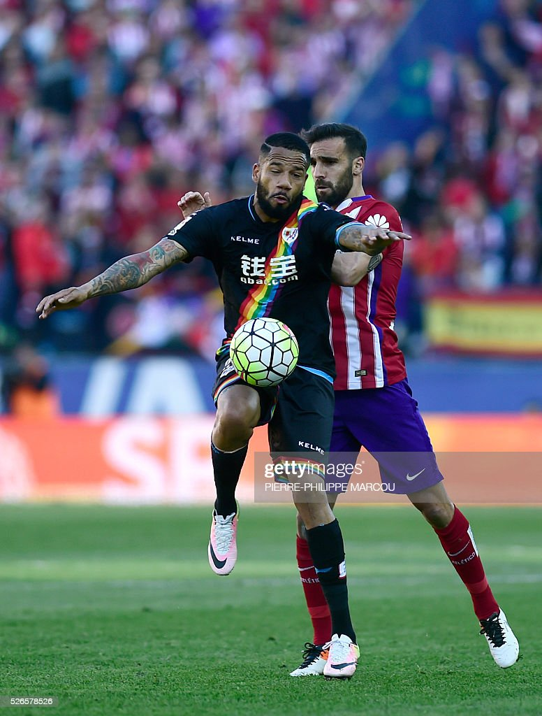 Atletico Madrid's defender Jesus Gamez (R) vies with Rayo Vallecano's Portuguese forward Bebe during the Spanish league football match Club Atletico de Madrid vs CF Rayo Vallecano at the Vicente Calderon stadium in Madrid on April 30, 2016. / AFP / PIERRE