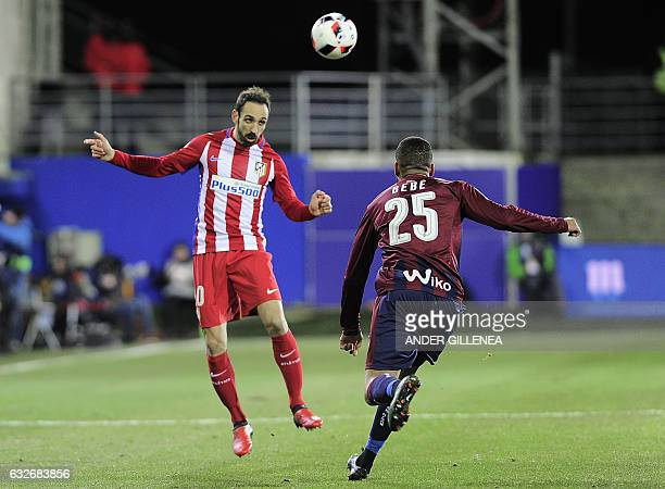 Atletico Madrid's defender Juanfran heads the ball past Eibar's Portuguese forward Tiago Manuel Dias Correia during the Spanish Copa del Rey quarter...