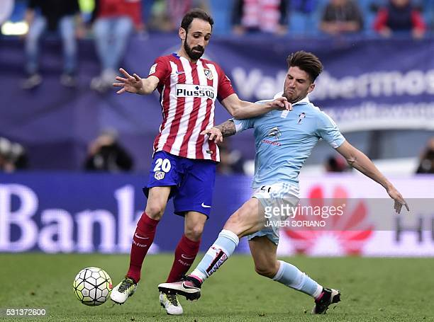 Atletico Madrid's defender Juanfran vies with Celta Vigo's defender Carles Planas during the Spanish league football match Club Atletico de Madrid vs...