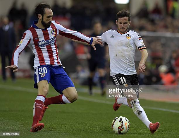 Atletico Madrid's defender Juanfran vies with Valencia's Argentinian forward Pablo Piatti during the Spanish league football match Club Atletico de...