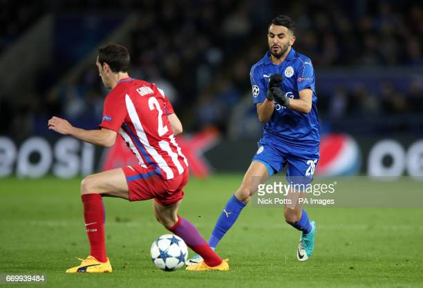 Atletico Madrid's Diego Godin and Leicester City's Riyad Mahrez battle for the ball during the second leg of the UEFA Champions League quarter final...