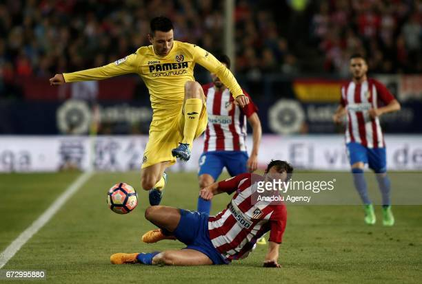Atletico Madrid's Diego Godin is in action against Villarreal's Antonio Rukavina during the Spanish soccer league La Liga football match Atletico de...