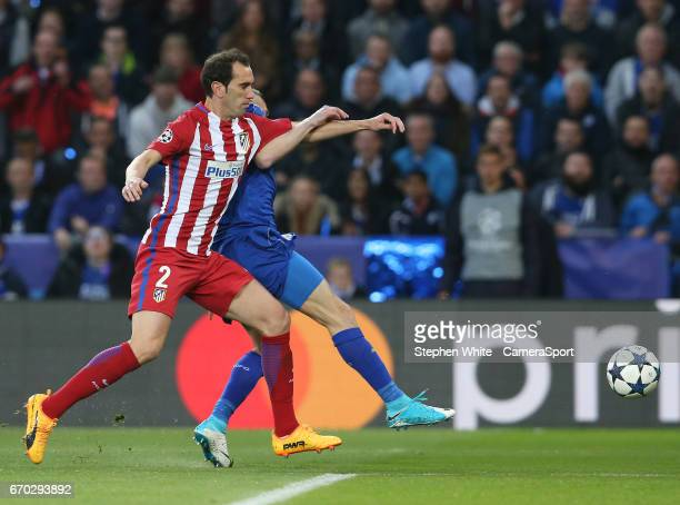 Atletico Madrid's Diego Godin manhandles Leicester City's Jamie Vardy during the UEFA Champions League Quarter Final second leg match between...