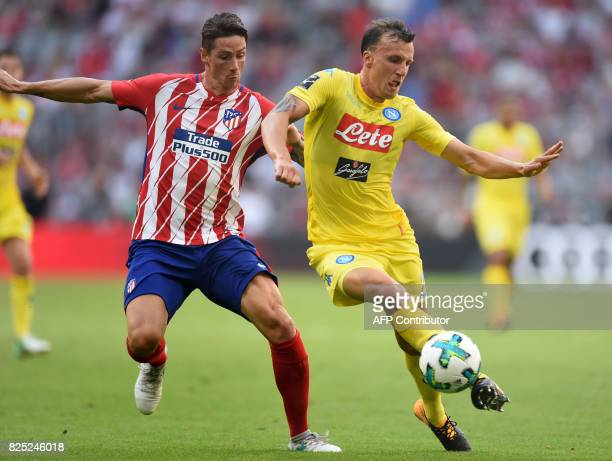 Atletico Madrid's Fernando Torres and Napoli's Romanian defender Vlad Chiriches vie for the ball during the first Audi Cup football match between...