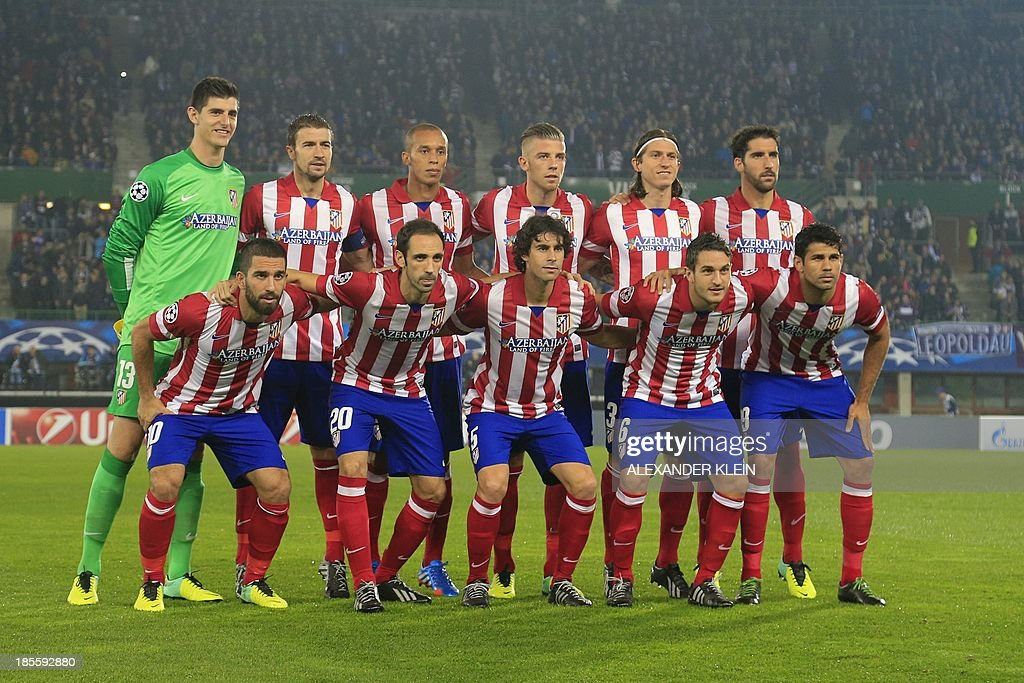 Atletico Madrid's football team player (top L-R) Belgian goalkeeper Thibaut Courtois, midfielder and captain Gabi, defender Joa Miranda de Souza, Belgian defender Tobias Alderweireld, Brazilian defender <a gi-track='captionPersonalityLinkClicked' href=/galleries/search?phrase=Filipe+Luis&family=editorial&specificpeople=3941966 ng-click='$event.stopPropagation()'>Filipe Luis</a>, midfielder Raul Garcia and (bottom L-R) Turkish midfielder Arda Turan, midfielder Juanfran, Portuguese midfielder Tiago Mendes, midfielder Koke and Brazilian forward Diego da Silva Costa poses for a team picture ahead of the start of a group stage UEFA Champions League football match between Austria Wien and Atletico de Madrid on October 22, 2013 at the Ernst Happel stadium in Vienna. Atletico Madrid's won 3-0. AFP PHOTO / ALEXANDER KLEIN