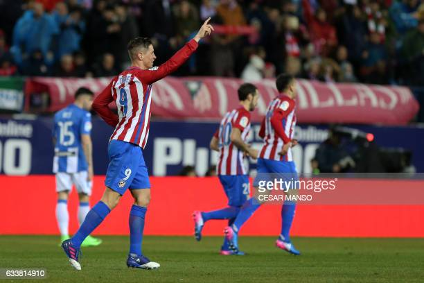 Atletico Madrid's forward Fernando Torres celebrates a goal during the Spanish league football match Club Atletico de Madrid vs Club Deportivo...