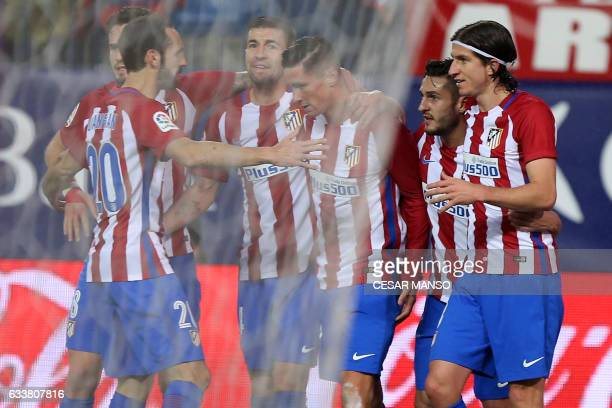 Atletico Madrid's forward Fernando Torres celebrates a goal with teammates during the Spanish league football match Club Atletico de Madrid vs Club...