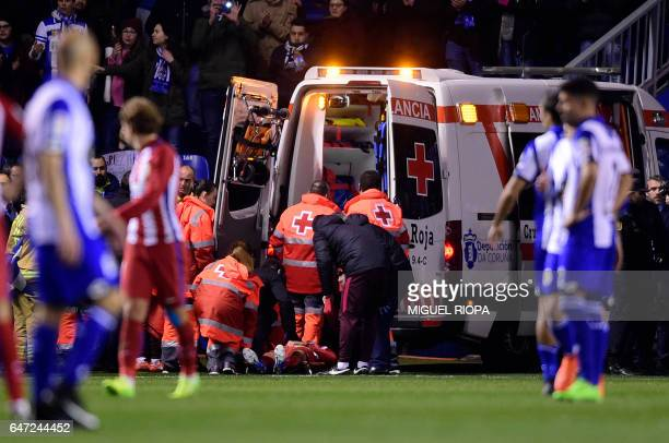 TOPSHOT Atletico Madrid's forward Fernando Torres is evacuated in an ambulance due to an injury during the Spanish league football match RC Deportivo...