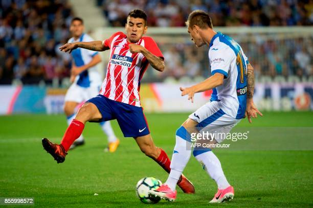 Atletico Madrid's forward from Argentina Angel Correa vies with Leganes' defender from Spain Raul Garcia Carnero during the Spanish league football...