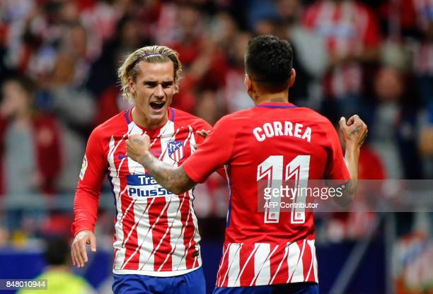 Atletico Madrid's forward from France Antoine Griezmann celebrates with Atletico Madrid's forward from Argentina Angel Correa after scoring during...