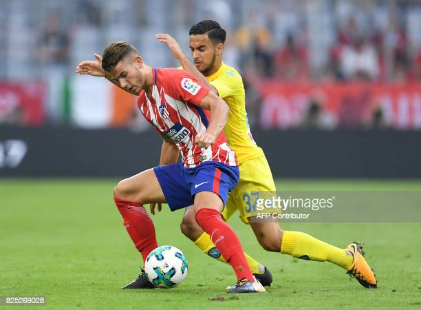 Atletico Madrid's French defender Lucas and Napoli's French striker Adam Ounas vie for the ball during the first Audi Cup football match between...