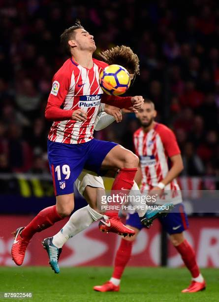 Atletico Madrid's French defender Lucas Hernandez vies with Real Madrid's Croatian midfielder Luka Modric during the Spanish league football match...