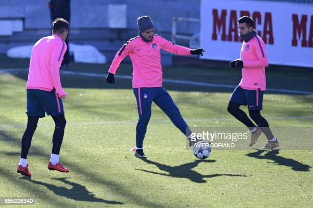 Atletico Madrid's French forward Antoine Griezmann and Atletico Madrid's Argentinian forward Angel Correa take part in a training session at Atletico...