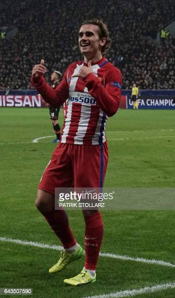 Atletico Madrid's French forward Antoine Griezmann and his teammates celebrate after scoring during the UEFA Champions League round of 16 firstleg...