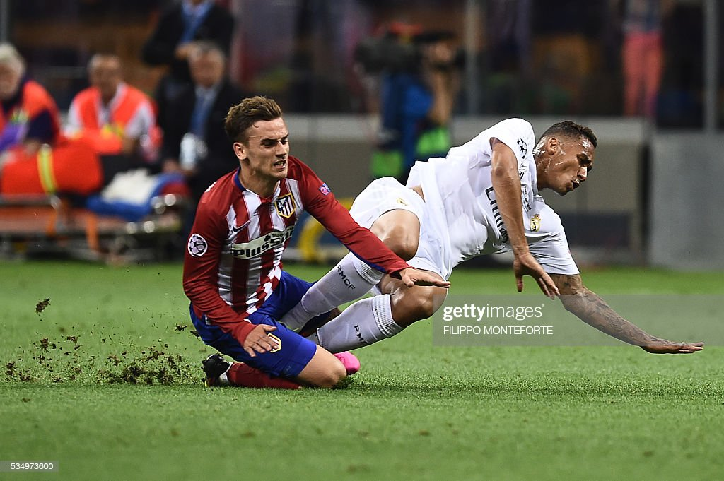 Atletico Madrid's French forward Antoine Griezmann (L) and Real Madrid's Brazilian defender Danilo fall during the UEFA Champions League final football match between Real Madrid and Atletico Madrid at San Siro Stadium in Milan, on May 28, 2016. / AFP / FILIPPO