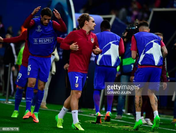 Atletico Madrid's French forward Antoine Griezmann Atletico Madrid's Croatian midfielder Sime Vrsaljko and Atletico Madrid players train before the...