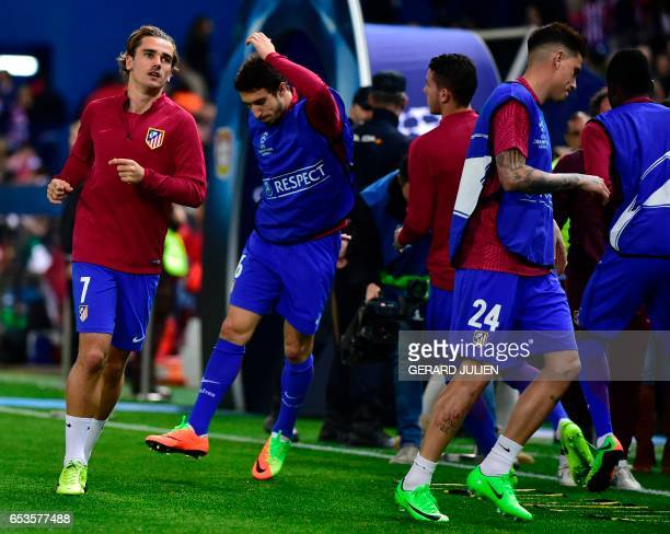 Atletico Madrid's French forward Antoine Griezmann Atletico Madrid's Croatian midfielder Sime Vrsaljko and Atletico Madrid's Uruguayan defender Jose...