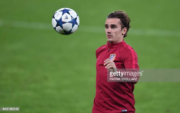 Atletico Madrid's French forward Antoine Griezmann attends a training session in Leverkusen on February 20 on the eve of the Champions League...