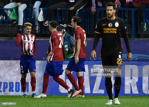 Atletico Madrid's French forward Antoine Griezmann celebrates a goal with teammates during the UEFA Champions League Group C football match Club...