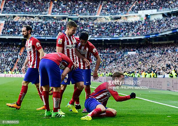 Atletico Madrid's French forward Antoine Griezmann celebrates a goal with teammates during the Spanish league football match Real Madrid CF vs Club...