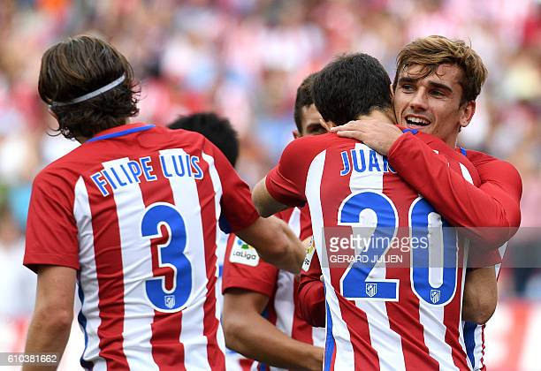 Atletico Madrid's French forward Antoine Griezmann celebrates a goal with teammates during the Spanish league football match Club Atletico de Madrid...