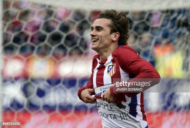 TOPSHOT Atletico Madrid's French forward Antoine Griezmann celebrates a goal during the Spanish league football match Club Atletico de Madrid vs...
