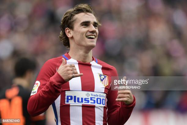 Atletico Madrid's French forward Antoine Griezmann celebrates a goal during the Spanish league football match Club Atletico de Madrid vs Valencia CF...