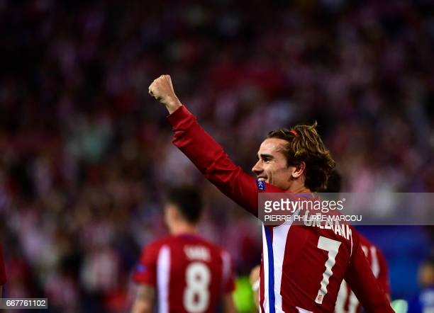 TOPSHOT Atletico Madrid's French forward Antoine Griezmann celebrates a penalty goal during the UEFA Champions League quarter final first leg...
