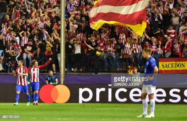 Atletico Madrid's French forward Antoine Griezmann celebrates a goal during the UEFA Champions League quarter final first leg football match Club...