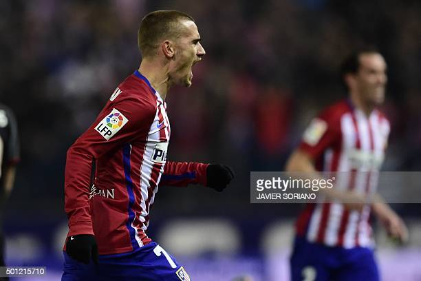 Atletico Madrid's French forward Antoine Griezmann celebrates after scoring a goal during the Spanish league football match Club Atletico de Madrid...