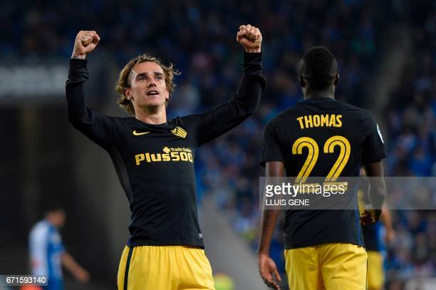 Atletico Madrid's French forward Antoine Griezmann celebrates after scoring a goal during the Spanish league football match RCD Espanyol vs Club...