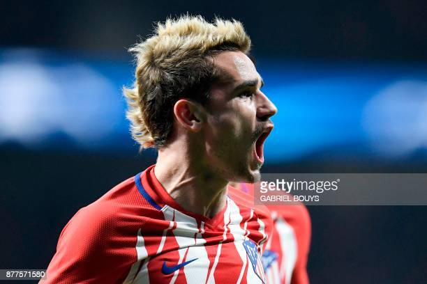 TOPSHOT Atletico Madrid's French forward Antoine Griezmann celebrates after scoring a goal during the UEFA Champions League group C football match...