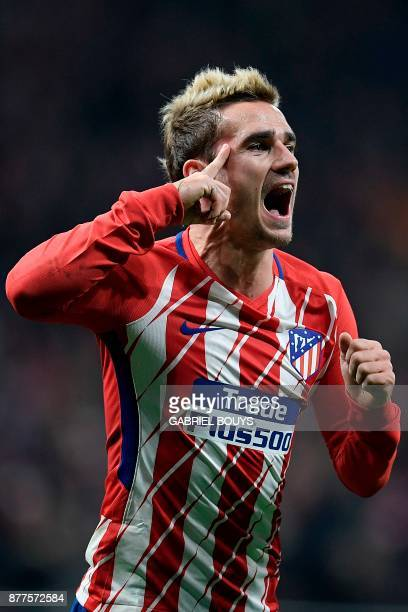 Atletico Madrid's French forward Antoine Griezmann celebrates after scoring a goal during the UEFA Champions League group C football match between...