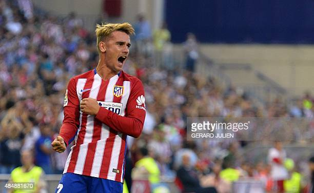 Atletico Madrid's French forward Antoine Griezmann celebrates after scoring during the Spanish league football match Club Atletico de Madrid vs UD...