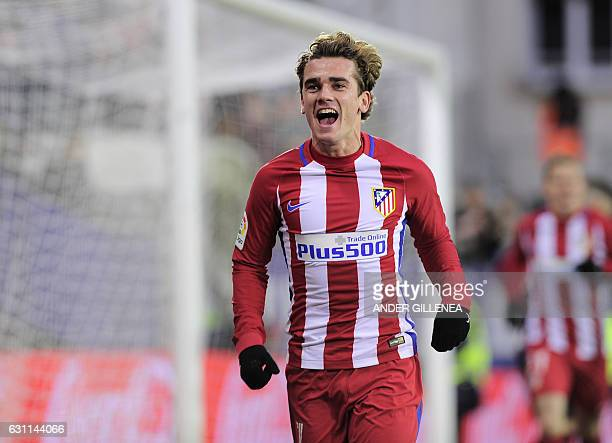Atletico Madrid's French forward Antoine Griezmann celebrates after scoring his team's second goal during the Spanish league football match SD Eibar...