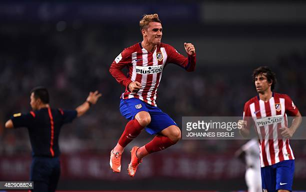 Atletico Madrid's French forward Antoine Griezmann celebrates his second goal during a friendly football match between Shanghai SIPG and Atletico...