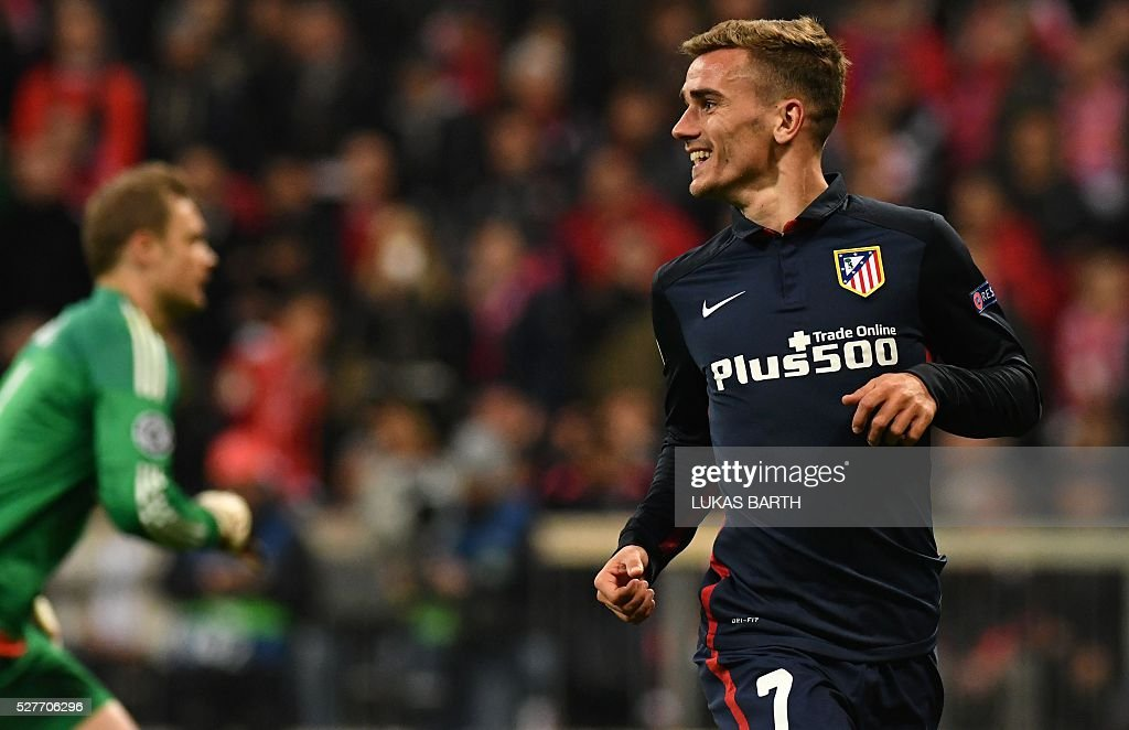 Atletico Madrid's French forward Antoine Griezmann celebrates scoring past Bayern Munich's goalkeeper Manuel Neuer during the UEFA Champions League semi-final, second-leg football match between FC Bayern Munich and Atletico Madrid in Munich, southern Germany, on May 3, 2016. / AFP / LUKAS